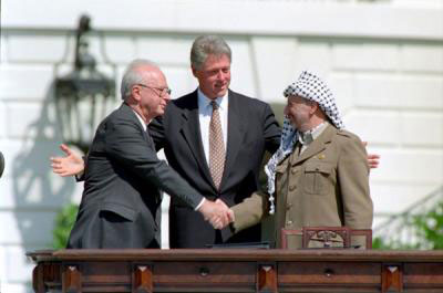 Israel Leader Yitzhak Rabin, PLO Leader Yasser Arafat, and U.S. President William J. Clinton